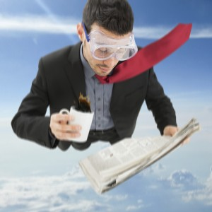 Portrait of a funny businessman skydiving while reading a newspaper